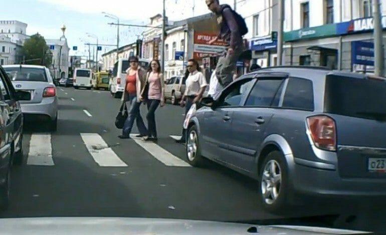 Russian Pedestrian Walks Across Car Bonnet to Make a Point