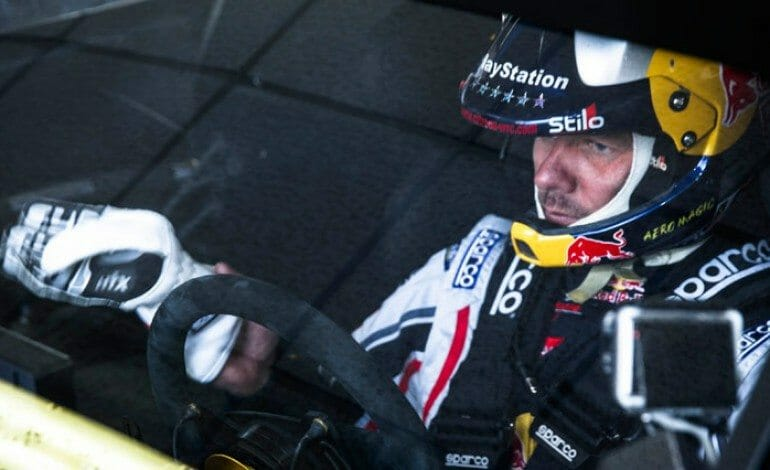 Sébastien Loeb takes his seat in the 208 T16 Pikes Peak