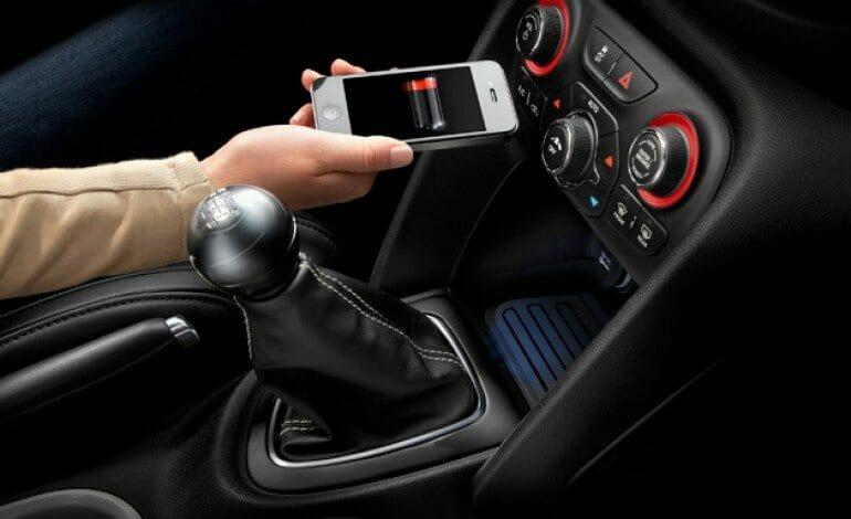 Wireless charging mat in car.