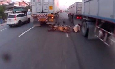 Lucky Biker Somehow Not Crushed By Two Trucks