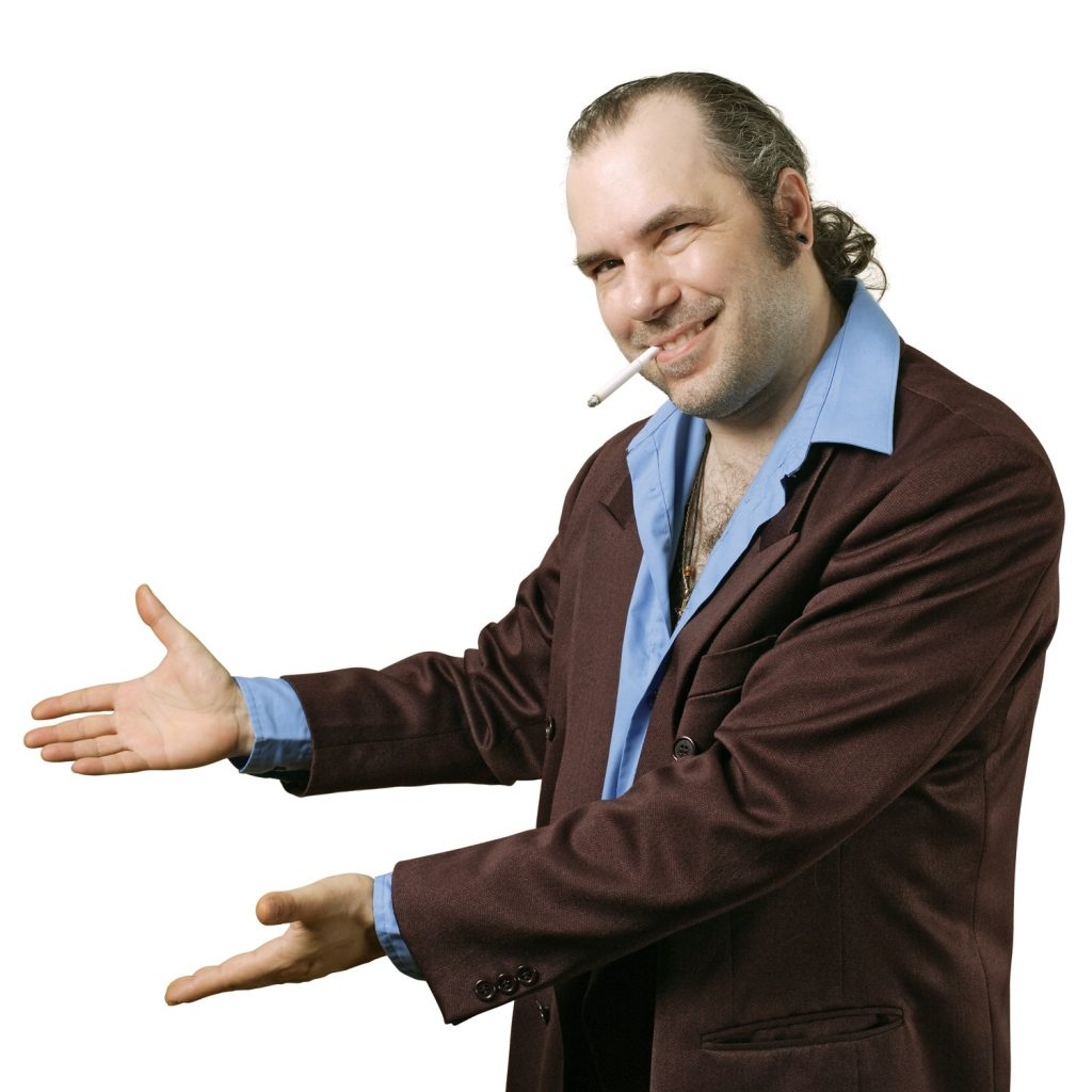 A sleazy car salesman, Con man, retro suit wearing man with happy smile showing you his deals.