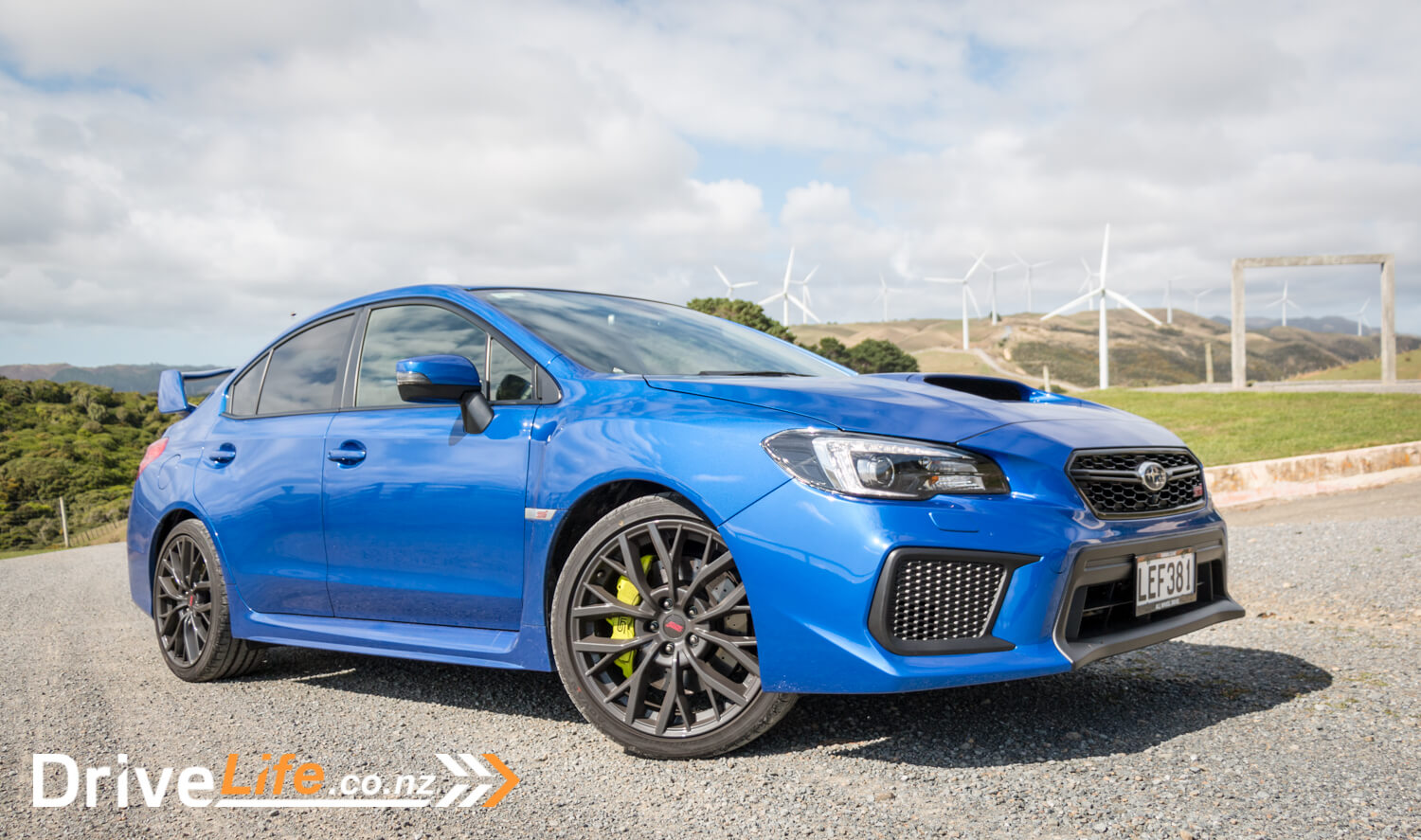 2018 Subaru Wrx Sti Premium New Car Review Full Time Race Mode Blue With White Rims The Wing Is Optional And Can Be Replaced A Style Lip Spoiler But I Think It Looks Great Suits Design Of Both From Side